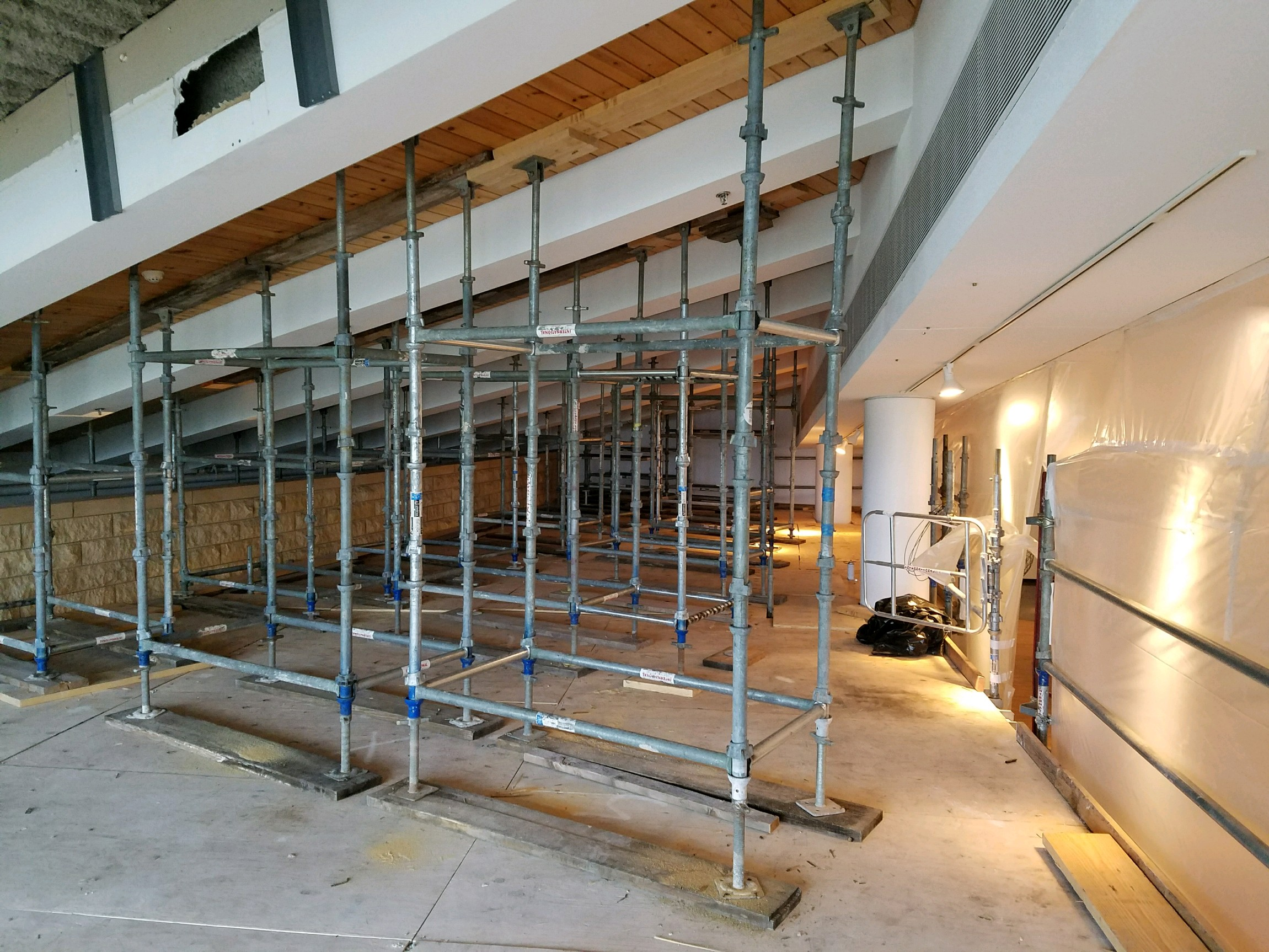 cuplock scaffolding system shown in a rooftop crawl space for a building restoration project - International Equipment