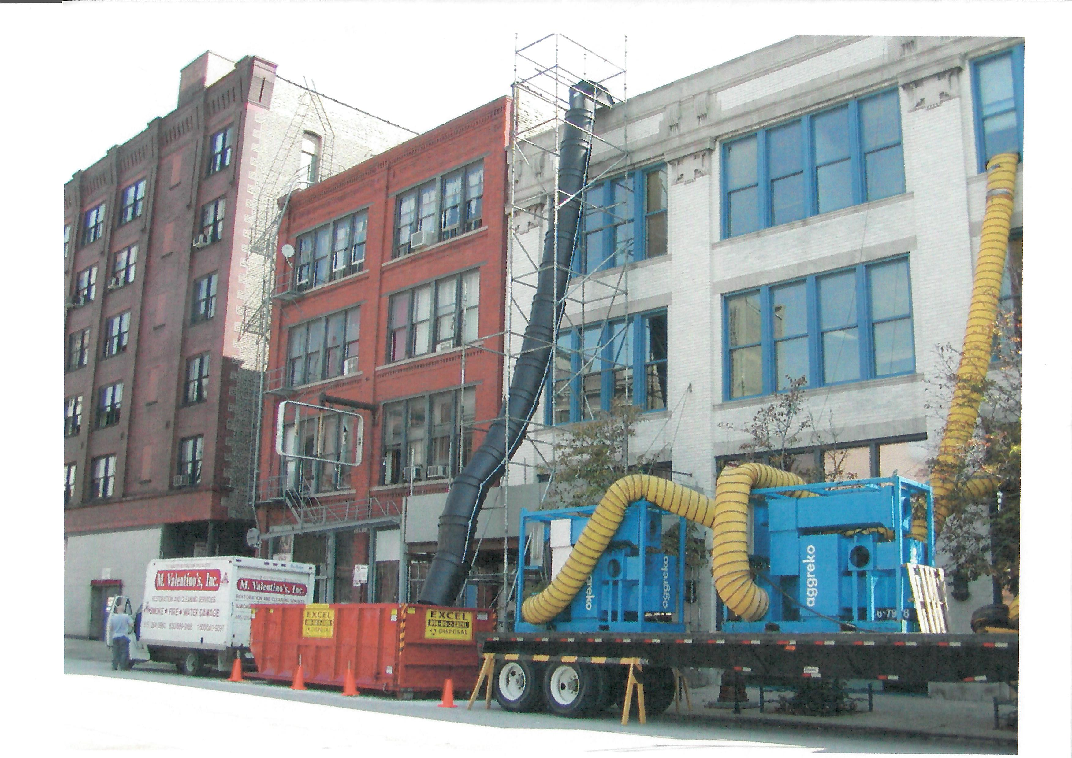 debris chute scaffolding system pictured in use for an older three-story building